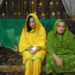 Bride on a pre-wedding ceremony with grandmother in Pakistan