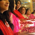 Pakistan - Girls waiting for the groom and his guests to shower them with rose petals