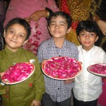 Pakistani Children with rose petals plates