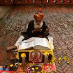 """I call him """"the rain maker""""! I found him one day as I was seeking refuge from the rain by the sound of his sang prayers and improvised wooden instrument."""