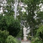 Statue of Buddha Amidst the Garden Green.