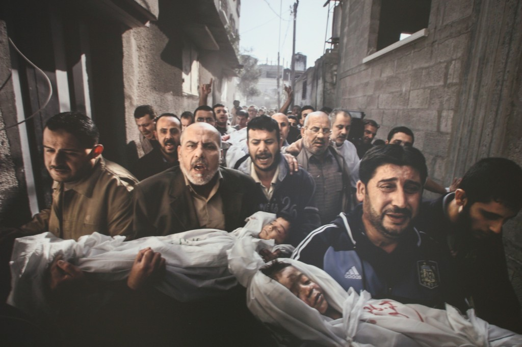 World Press Photo of the Year by Paul Hansen (Sweden). Gaza City after the Israeli attacks.