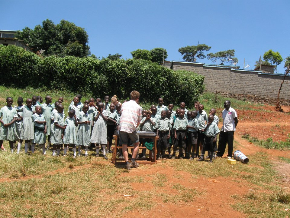Bard College Berlin BA student Lucas Cone from Denmark teaching music during his self-planned project in a school in Kenya