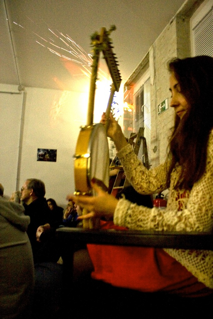 "A BCB student trying out Joulia's instrument, the so called ""Berlin Lyre"""