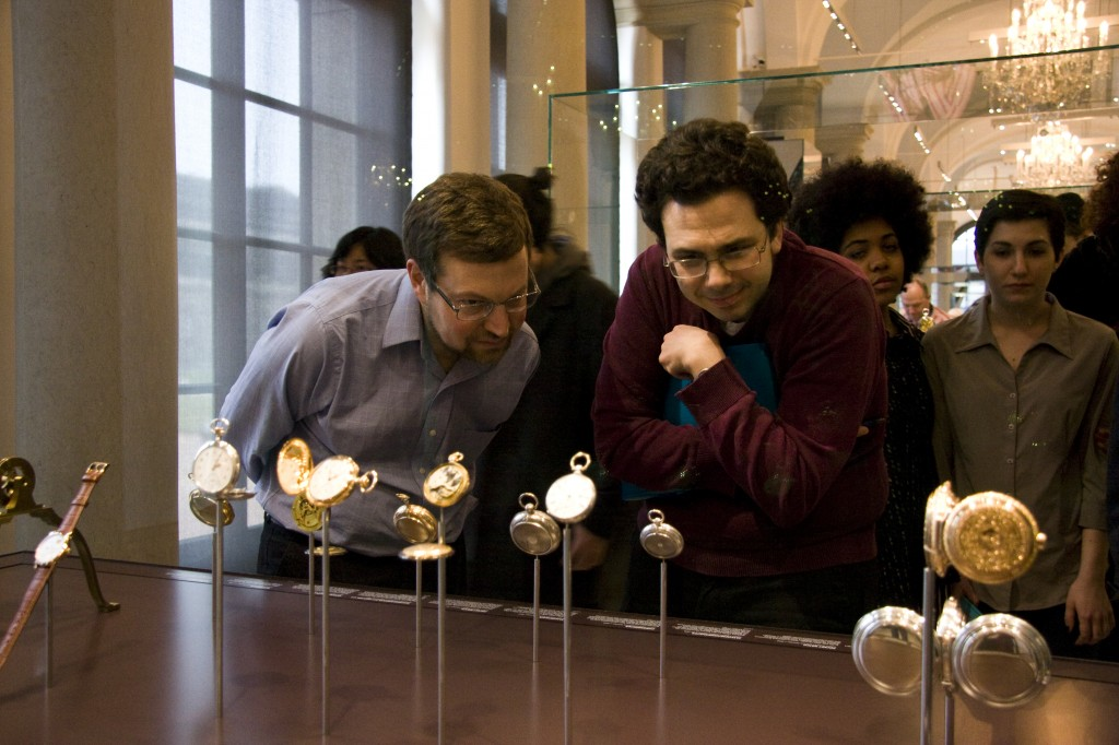 Professors Geoff Lehman and Michael Weinman captivated by a series of old pocket watches. (Photo by Inasa Bibić)