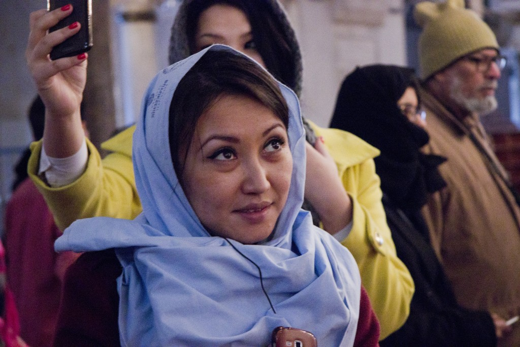 An AUCA (American University of Central Asia) alumna and panelist in awe of the mosque's adornments. Photo: Inasa Bibic
