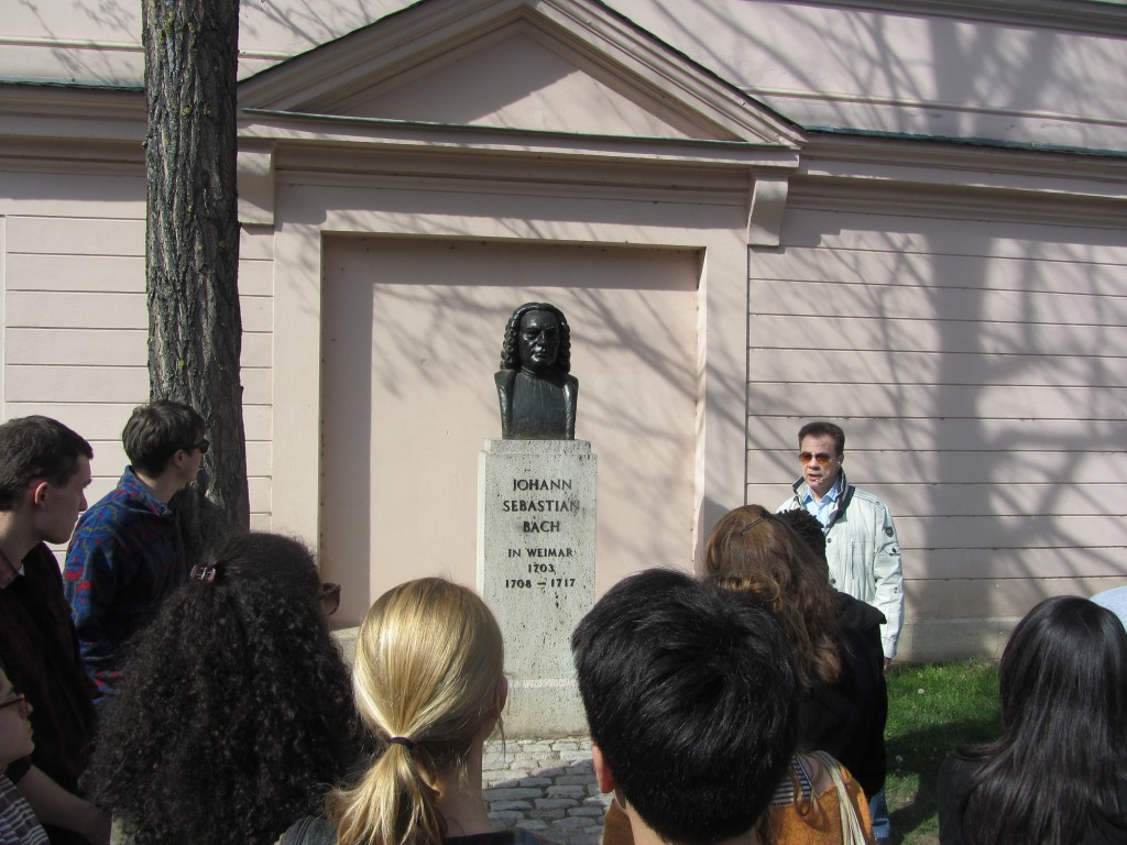 Students learn of Weimar's many influential residents (Bach included) in the sun during guided walking tour.