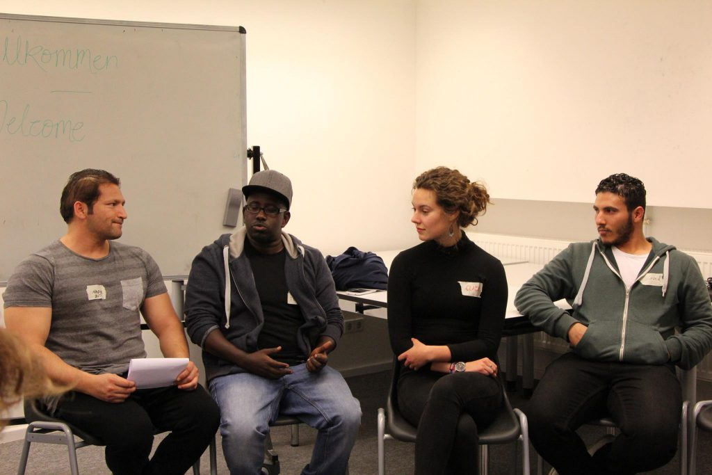 BCB student Clara Holder in discussion with other participants (Credit: Tamar Maare)