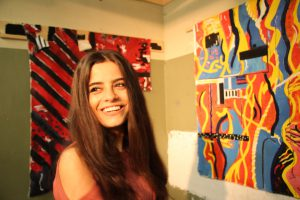 Wafa at a student artwork exhibition on campus (credit: Tamar Maare)